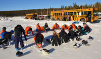 Tyler Marley leads athletes in warm-up exercises before they hit the slopes. Photo by Terry Allen.